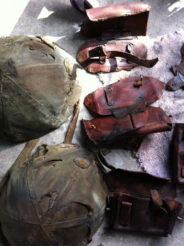 Dye Dept studio snapshot, Army Artefact, 2013. Leather objects, metal and canvas helmets, texture added, acrylic paint, leather oils.