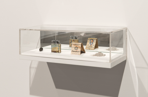 """Paul Kajander. As they are, what they are, that they are, together, (apart from smog & smoke), 2014, Ancient coin from the Macedonian Kingdom, vintage Penguin lighter, Greek War Relief matchbook, volcanic ash from Mt. St. Helens eruption, custom vitrine with mirror. 4 3/4"""" x 14.75"""" x 6.25"""""""