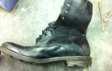 Dye Dept studio snapshot, New Boot, 2013. New leather boot, texture added, acrylic paints, waxes.