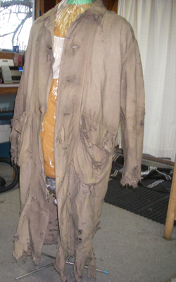 Dye Dept studio snapshot, Overcoat, 2013. Linen overcoat, texture added, acrylic paint, waxes.