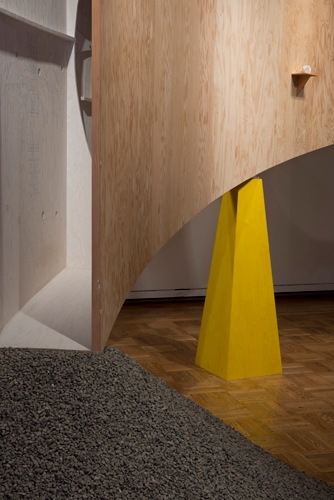 "Setting a Corner detail, 2013, Plywood, wood, steel, paint, gravel. Photo by Mark Stien. 148""x220″x200"""
