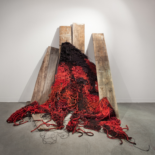 Cradling: In Ruins 2014 6' x 5' x 4' Found barn wood, hand-dyed and burned sisal  Photo credit: Thomas Blanchard